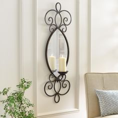 Add unique lighting to a room in your home with the Mirrored Metal Scroll Sconce! In addition to its scrolling design, it also features a mirror that will reflect the candlelight in a beautiful way.