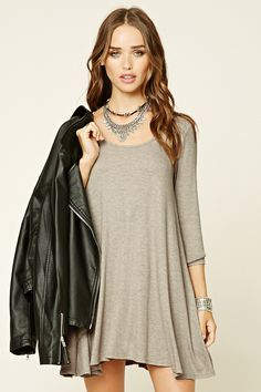 A ribbed knit swing dress featuring a scoop neckline, 3/4 sleeves, and a flared hem.