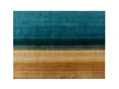 The Paysages Rug is part of the GAN Hand Knotted Collection, a collection of rugs that are all made by hand.