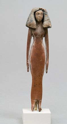 Statuette of woman. Period: Middle Kingdom. Dynasty: Dynasty 12–13. Date: ca. 1981–1640 B.C. Geography: From Egypt, Memphite Region, Lisht North, west of pyramid of Amenemhat I, so-called Toilet Basket I without burial. Medium: Wood, paint