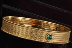 Bold gold 'kada'  Gold 'kada' crafted by hand in 18k gold features a rich green emerald. Gold Jhumka Earrings, Gemstone Earrings, Gold Bangles Design, Jewelry Design, Designer Bangles, Emerald Jewelry, Gold Jewelry, Jewelry Box, Jewelry Gifts
