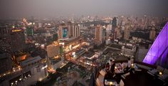 """""""The most stunning rooftop bar you'll ever see"""" according to The New York Times and a highlight of Bangkok's nightlife scene. Smiling People, Sky Bar, Beaches In The World, Rooftop Bar, Bangkok, Photo Credit, Night Life, Times Square, Thailand"""