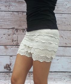 "Only $8.99! | These layered scalloped crochet shorts are just adorable. Ornate crocheted layers descend from a wide, high-rise waistband with hidden elastic all the way down to the hem of these short shorts. Fully Lined. Shorts length measure approximately 11""-12"" from waist band to bottom hem. 