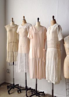 Vintage dress forms dressed in 1920s and 1930s finery