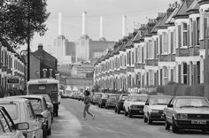 A street in London's Battersea, with Battersea Power Station at the far end, circa 1980.