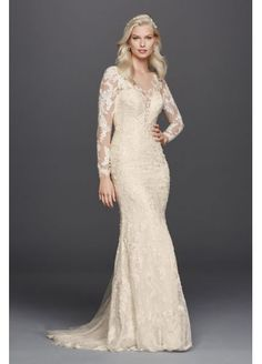 Lace Long Sleeve Illusion V-Neck Wedding Dress SWG727 -I love this dress! The buttons down the back, the ivory color, the illusion v neck the appliqué sleeves, the lace!! Ugh it's pretty much perfect!