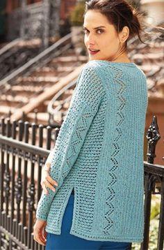 Вязаный женский пуловер с боковыми шлицами