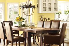 I like the yellow with the dark wood. I always thought I would prefer light wood. But, the lighter wood would give it more of a country feel and I think I would like that better. This is more elegant, but I don't want kids sitting on leather chairs lol.
