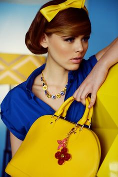 yellow bag with cobalt blue outfit and yellow bow headband