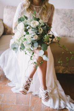 wedding bouquet with silver dollar eucalyptus - photo by Nastja Kovacec http://ruffledblog.com/a-tuscan-dream-wedding-come-true