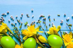 easter background with daffodils and easter eggs on wooden table