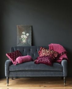smoke gray velvet couch with pink cushions
