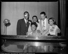 Earl 'Fatha' Hines, Erroll Garner, Billy Eckstine, Maxine Sullivan and Mary Lou Williams gather around a piano in Syria Mosque in Pittsburgh for Night of Stars, August 7, 1946