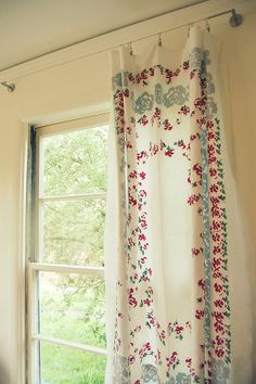 Vintage tablecloth as curtain; I'm so doing this...that hardware is from IKEA.