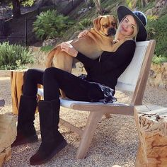 Fail proof weekend wear? Take a cue from @kaitlynn_carter and pair a trusty plaid number with leggings, a floppy hat, and the new #ClassicSlim Kara boot. Add your pup to complete the look. #hugitout  Shop link in our bio.