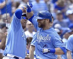 Kansas City Royals' Alex Gordon is congratulated by Salvador Perez after hitting a solo home run in the fourth inning during Sunday's baseball game against the Baltimore Orioles on April 24, 2016 at Kauffman Stadium in Kansas City, Mo.