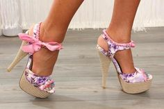 Multicolored Flower Patterned Peep Toe Platform heels with bows on the ankle straps and woven straw heels.