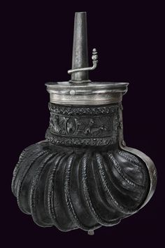 A beautiful Cuir-Bouilli powder-flask Wooden body covered with embossed, boiled leather; the neck framed by laurel crowns, at the centre an oval shield and dragons. provenance: Italy dating: third quarter of the Century. Sword Hilt, Powder Horn, Arm Armor, Italian Renaissance, Museum Of Fine Arts, Ancient Art, 16th Century, Game Design, Leather Case