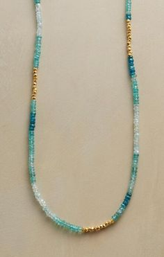 An apatite, aquamarine and gold vermeil necklace that mixes contrasting tones with stunning results.