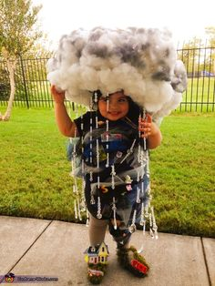 Lori: My daughter Penelope is a Twister Tornado. She is wearing a cloud hat complete with lighting and plane flying through, with clear bead rain falling, Her costume is made of...