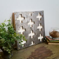 This modern swiss cross was cut using a CNC plasma machine. It's elevated from the heirloom white stained wood for a fantastic 3D look. Amazing from all angles.12X12