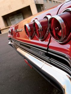 1965 Chevrolet Impala SS.  The protruding round tail lights gave the '65 away.