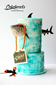 Shark BUSTING Through the Cake! (And an Easy Water Effect Finish is part of Shark Busting Through The Cake And An Easy Water Effect Finish - How to make a shark busting through a cake! Shark cake tutorial on Cakeheads com! Ocean Cakes, Beach Cakes, Crazy Cakes, Shark Birthday Cakes, Shark Cake, Nautical Cake, Animal Cakes, New Cake, Birthday Cake Decorating