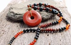 boho red jasper donut and obsidian statement necklace by the Spiral River