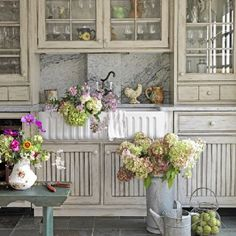 Shabby chic kitchen. Love the cabinet color