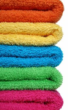 How to get the mildew smell out of towels.  Use white vinegar in a hot wash, then in the next wash use baking soda also in hot.