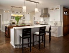 We love a darker island with crisp white cabinetry!