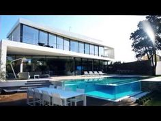 Located in Marbella, Spain. This modern villa was designed by that has a stunning view of the Mediterranean Sea and being surrounded by water Spanish Holidays, Modern Minimalist House, Pool Houses, Stunning View, Residential Architecture, Beautiful Homes, Villa, House Design, Cool Stuff
