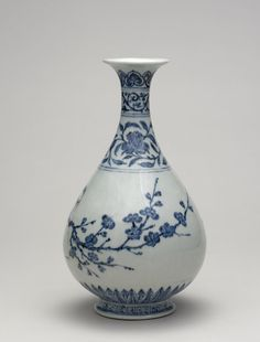 Porcelain bottle of yuhuchun ping form with flaring mouth rim. Underglaze blue with two song birds on a flowering prunus branch. Bands of scrolling flowers and scrolls on neck. Ruyi heads just below mouth rim, squared spirals on the foot and plantain leaves rising from the base.