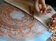 Lenka's bobbin Lacemaking technique with copper wire.