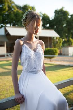 This stunning floor length faux silk and lace wedding dress is perfect for the romantic bride. It has a unique hand made lace embroidery on the upper part and a flowing skirt. The lace belt continues all the way to the back. The dress is one piece.  ♥ Simple wedding dress | Boho wedding dress | Romantic wedding dress | Vintage wedding dress | See more @ http://www.whiteandlace.com/