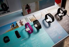 The line of Fitbit products are displayed during a lunchtime workout event outside the New York Stock Exchange during the IPO debut of the company in New York City.