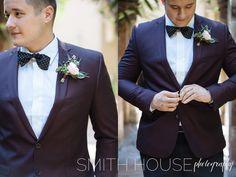 Maroon Suit Jacket &  polka dot Bowtie for the groom -- fall wedding inspiration: Nordstrom | Boutonniere: Flower Vibes | Venue: Las Velas, Houston, Texas wedding venue