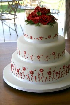 Red & white wedding cake By sweetbitescakes on CakeCentral.com