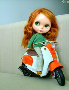 Scooter riding Kenner girl. Photo by J*me on Flickr.