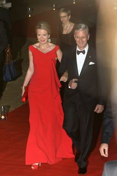Queen Mathilde in a new gown from Natan and King Philippe on their way to the concert in the evening of their second day in Poland.