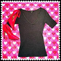 """JUST IN Stunning Express charcoal v neck top JUST IN Stunning Express charcoal v neck top. Silver beading at neckline. Lightweight, stretchy, & super soft cotton blend. Worn once & in flawless condition! Measures approx 24"""" long, 6"""" sleeves, & 16"""" across chest. Size small. Bundle to save 10%!NO TRADESI love reasonable offers! Please make one using the offer button Express Tops"""