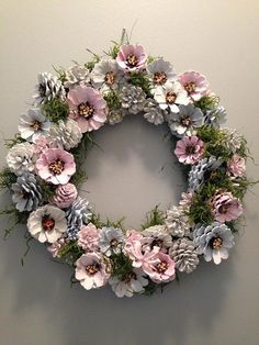 This unique pine cone wreath in shades of blue, gray, pink and white would make a lovely house-warming gift or brighten up your own home. Each pine cone is hand