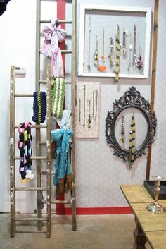 I like the idea of ladders as scarf storage