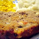 Incredibly Cheesy Turkey Meatloaf Recipe. We love this meatloaf recipe... with an onion, 2 cloves of garlic, grated zucchini, and grated carrot added. :D