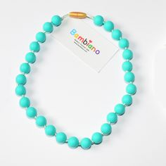 Bambiano Nicole Jr Necklace in Turquoise. Bambiano Jr Necklaces are made of 100% Food grade silicone. BPA free, Lead free and nontoxic. Fashionable for trendy girls 3 years and above. Necklaces are colourful, washable and soft against the skin. Shop at www.bambiano.com