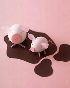 Puddly Pigs - Pink plastic eggs, pipe cleaners, craft paper, button for nose and embroidery floss for tail