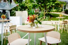 """LETTUCE & CO - STYLE. EAT. PLAY 'cheers to 100 years"""" - joint 50th birthday celebrations.' tropical summer nights theme. clear span, clear roof marquee, natural lotus bar stools, tropical flower arrangements. private party. concept design and event styling by lettuce & co."""