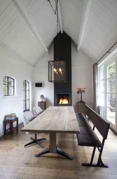 With the pitched ceiling it looks church-like. Love the focus placed on the hearths and the light is a great modern twist