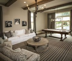 Thompson Custom Homes: Family game room features rustic exposed wood beams and clay colored walls ...