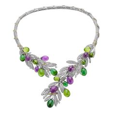 BULGARI 's OliveNecklace from the Festa collection celebrates the olive harvest with an abundance of Peridots, Amethysts and Tourmalines surrounded by Diamonds to imitate an olive branch that curls around the neck (POA).
